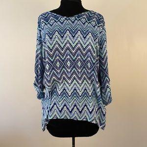 Asymmetrical hem blouse geometric chevron pattern